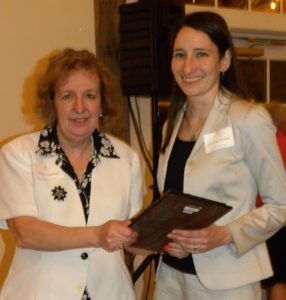 Lancaster attorney Elaine Ugolnik presents the Nast Pro Bono Award to Lindsay O'Neil.